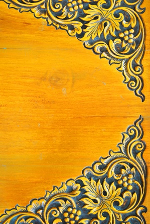 Gold surface of thai design wood table photo