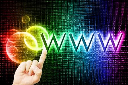 worldwideweb: Beautiful rainbow bokeh with worldwide-web word and hand touch on the black background Stock Photo