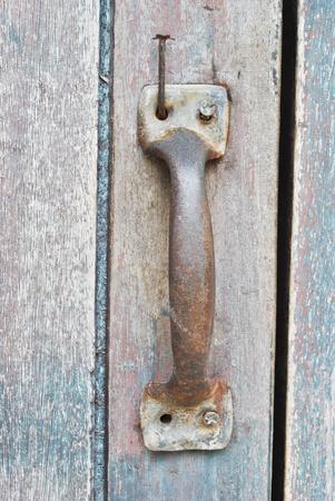 Rusty old handle wooden door and snail photo