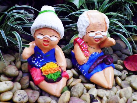 family picture: Beautiful doll clay grandfather and grandmother in garden