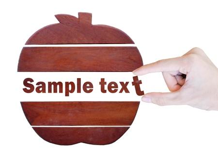 Holz-Apfel-Folie in einer Stücke mit Pick Wort auf weißem Hintergrund