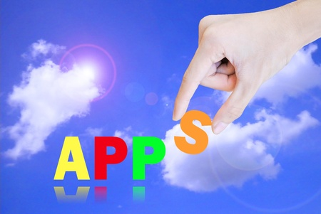 Hand pick and lift button apps word on the sky Stock Photo - 10684693