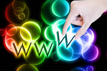 worldwideweb: Beautiful rainbow bokeh and hand pick worldwide-web word on the black background