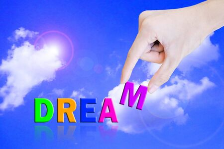 Hand pick and lift button dream word photo