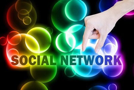 event marketing: Hand pick and lift button social network word on the bokeh