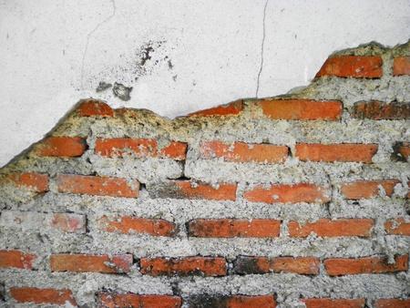 Texture background surface broken brick wall cement        photo