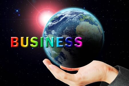 maketing: Hand hold the earth and sun ray with business word Stock Photo