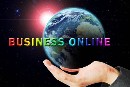 Hand hold the earth and sun ray with business online word photo