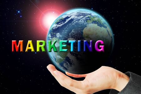 maketing: Hand hold the earth and sun ray with marketing word Stock Photo