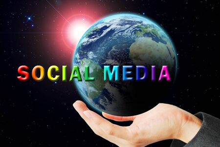 maketing: Hand hold the earth and sun ray with social media word