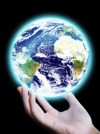 new technologies: Hand touch the earth on black background Stock Photo
