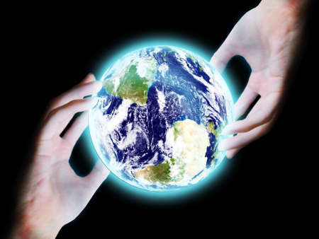 maketing: Hand touch the earth on black background Stock Photo