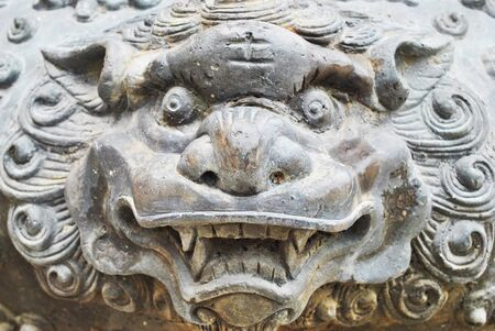 dragon head: Face lion statue is in the temple