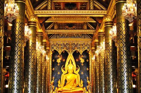 thai ethnicity: The golden buddha statue in temple bangkok thailand