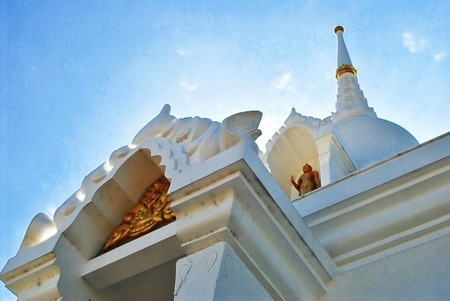 The beautiful white pagoda in thailand with sunshine photo