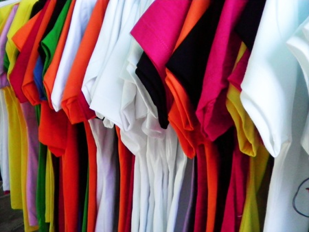 The colorful row of shirt is on the hanger