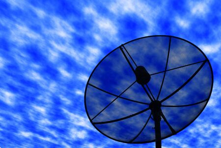 Satellite dish is on the blue sky photo