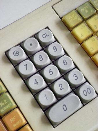 removing debt: Texture background surface keyboard cash machine money