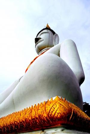 godhead: White buddha statue is in the courtyard