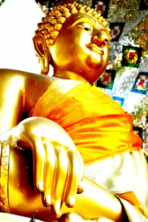 Closeup at hand of the gold buddha statue photo