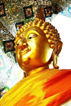 Closeup at head of the gold buddha statue Stock Photo - 14397406
