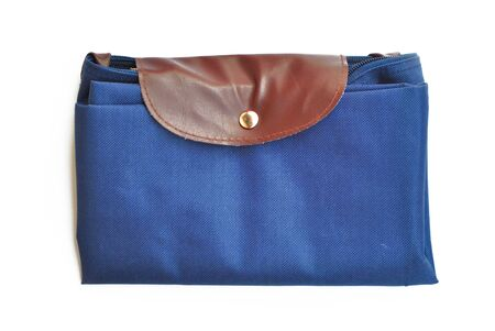 The blue handbag is on the white background photo