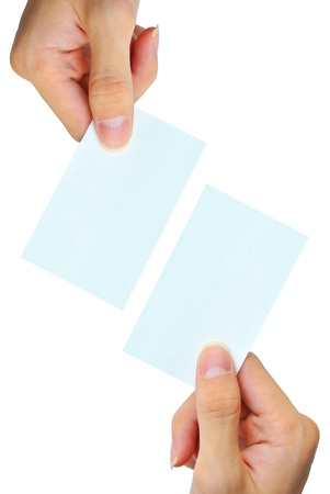 The hand is grasping the white empty name card Stock Photo
