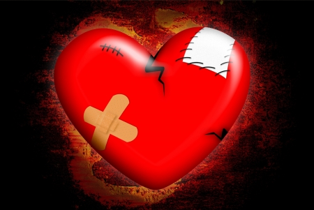 wounded heart: The heart broken on the black background Stock Photo