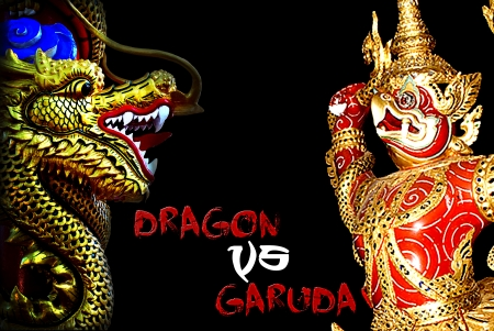 baclground: Chinese dragons and garuda statue in black baclground