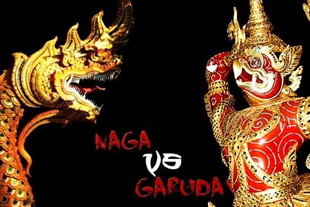 baclground: Naga and garuda statue in black baclground