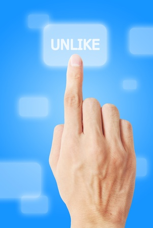 unlike: Hand touch unlike button Stock Photo