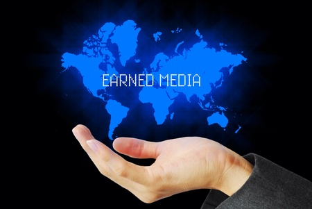 the publisher: Hand touch earned media  technology background Stock Photo