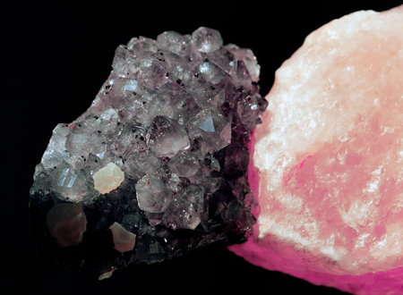 Gemstone Quartz and salt closeup as a part of cluster geode filled with rock crystals.