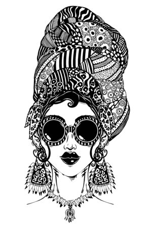 Young glamorous beautiful woman in urban style with traditional elegant geometric glasses, earrings and head wrap.