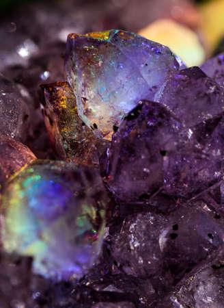 Iridescent natural transparent glossy and magic geometric Quartz crystal stucture through sun light.