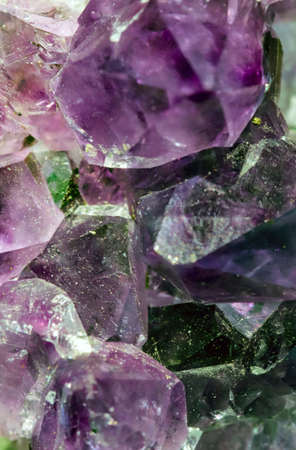Beautiful crystal magic amethyst gem stone. Texture of specimen with scattered natural light effect. Stockfoto