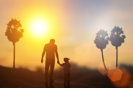 Child, baby holding an adults hand. Father and son on a walk. Happy lovely  with sun sets blurred. Little having fun time activity .play joy two worker art hold luck old hair skin white design tree.