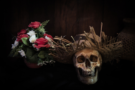 Awesome pile of skull on a brown wooden plank background. Still life style or selective focus and adjustment color for background.
