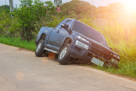 Front of blue car get damaged by accident fall the road who drowsiness and negligence while driving. Stock Photo