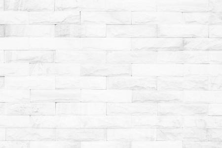 Cream and white brick wall texture background. Brickwork or stonework flooring interior rock old pattern clean concrete grid uneven bricks design stack. Stock Photo