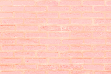 Pastel and pink brick wall texture background. Brickwork or stonework flooring interior rock old pattern clean concrete grid uneven bricks design stack.