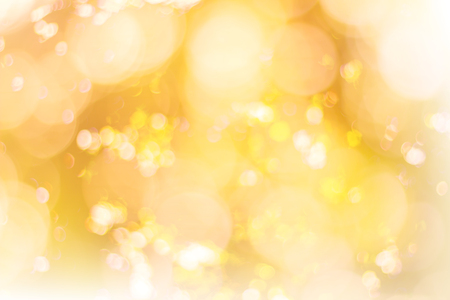 Abstract glamorous white silver and gold bokeh lights glitter sparkle. Defocused background have luxury golden color party invite for birthday, anniversary, holliday, new yeara€?s eve or Christmas.