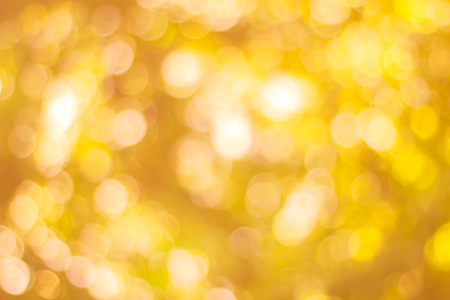 Abstract glamorous white silver and gold bokeh lights glitter sparkle. Defocused background have luxury golden color party invite for birthday, anniversary, holliday, new year's eve or Christma