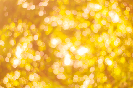 Abstract glamorous white silver and gold bokeh lights glitter sparkle. Defocused background have luxury golden color party invite for birthday, anniversary, holliday, new year's eve or Christmas.