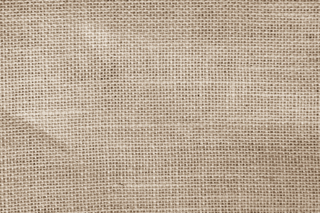 Vintage Brown abstract Hessian or sackcloth fabric or hemp sack texture background. Wallpaper of artistic wale linen canvas. Blanket or Curtain of cotton pattern with copy space for text decoration. Stock Photo