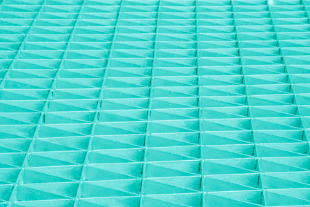 Pastel Blue Abstract metallic triangle or stainless steel texture black silver textured pattern background sheet of metal covered with lines of rolled steels.