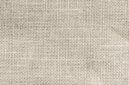 Vintage abstract Hessian or sackcloth fabric or hemp sack texture background. Cream Wallpaper of artistic wale linen canvas. Blanket or Curtain of cotton pattern with copy space for text decoration.