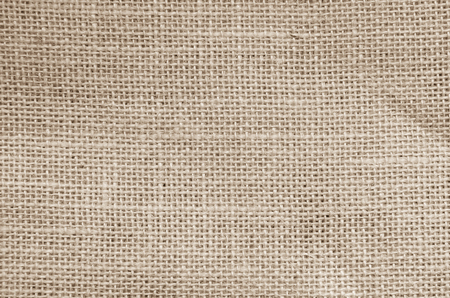Vintage abstract Hessian or sackcloth fabric or hemp sack texture background. Brown Wallpaper of artistic wale linen canvas. Blanket or Curtain of cotton pattern with copy space for text decoration.