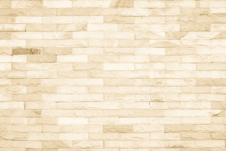 Cream colors and white brick wall art concrete or stone texture background in wallpaper limestone abstract paint to flooring and homework/Brickwork or stonework clean grid uneven interior rock old. Archivio Fotografico