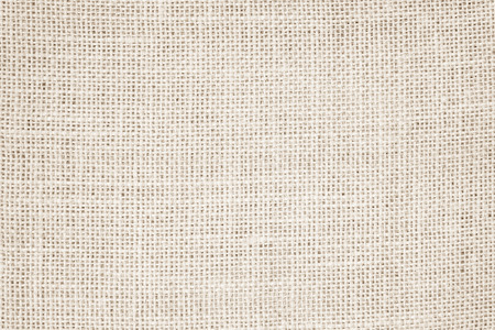 Vintage abstract Hessian or sackcloth fabric or hemp sack texture background. Wallpaper of artistic wale linen canvas. Blanket or Curtain of cotton pattern with copy space for text decoration. Stock Photo